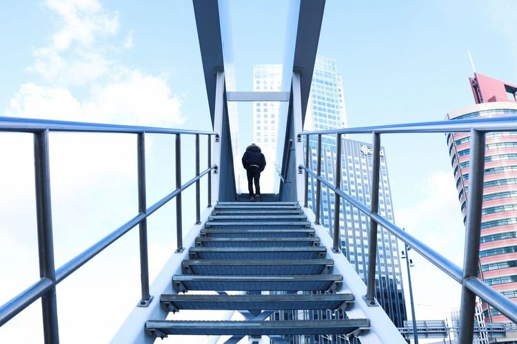 Up! One Person Architecture Real People Railing Built Structure Sky Lifestyles Day Men Steps And Staircases Cloud - Sky Building Exterior Outdoors The Way Forward