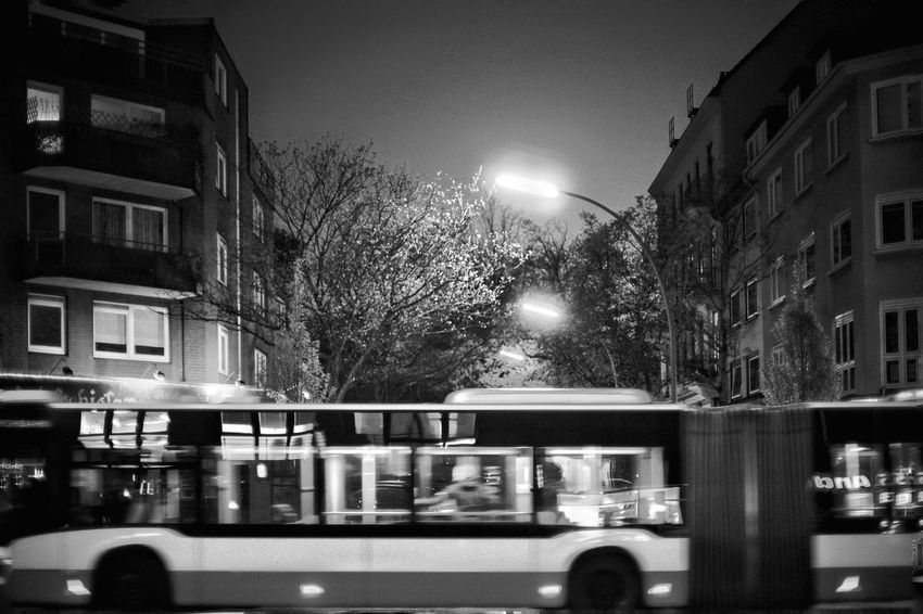 Fast Bus in BNW Black And White Mode Of Transportation Building Exterior Architecture Transportation Built Structure Land Vehicle Car Motor Vehicle Public Transportation Residential District Illuminated Street Tree Building Motion on the move Bus No People Night City