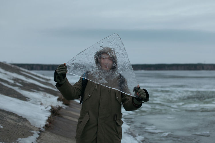 Cold Temperature Day Frozen Holding Ice Lifestyles Men Nature One Man Only One Person Only Men Outdoors People Russia Snow Triangle Water Winter