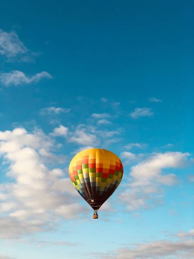 Low angle view of hot air balloon flying against sky