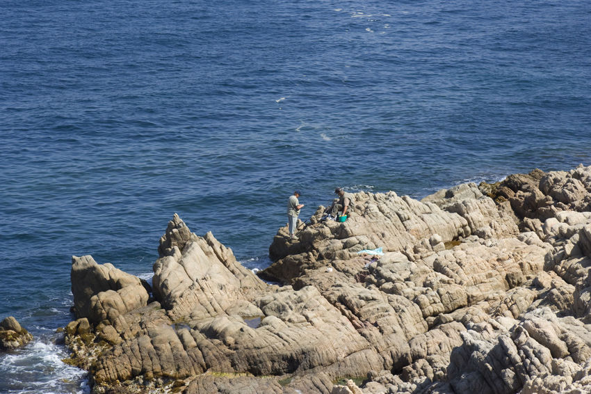 cliffs with fishermen - gulf of saint-tropez, French Riviera Angler Beauty In Nature Cliff Cliffs Côte D'Azur Fisherman Fishing Rod France Full Length Gulf Of Saint-tropez High Angle View Leisure Activity Mediterranean Sea Nature People Provence Rock - Object Rock Formation Rocky Coastline Saint-Tropez Sea Seascape Steep Tranquility Water