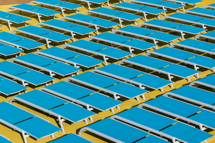 sun loungers on deck of a cruise ship Aida Cruise Ship Morning Relaxing Blue Day Empty Low Angle View Metal No People Outdoors Pattern Sky Sun Bathing Sun Lounger Yellow