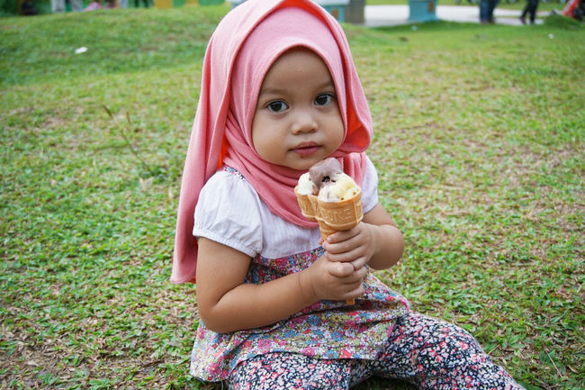 childhood Cute Day Field Focus On Foreground Front View Grass Grassy Green Color Holding Innocence Leisure Activity Lifestyles Muslimgirl Muslimahtoday Looking At Camera Outdoors Park - Man Made Space Person Summer Toddler
