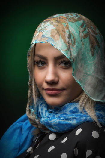 Portrait Of Beautiful Fashion Model Wearing Hijab Against Colored Background