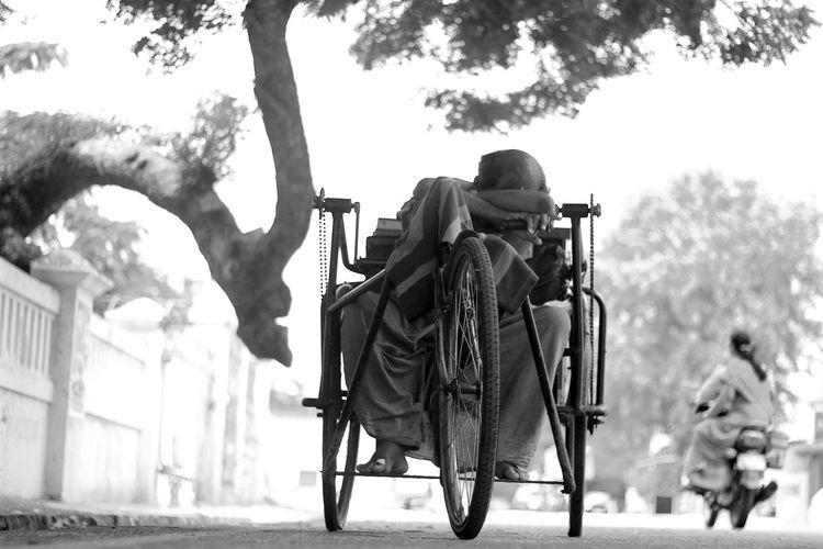 Low angle view of man sitting on wheelchair