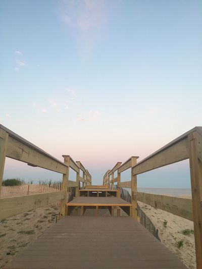 Entrance to the beach. Beauty In Nature Blue Boardwalk Bridge - Man Made Structure Built Structure Cloud Day Diminishing Perspective Empty Engineering Idyllic Long Nature No People Outdoors Pier Scenics Sky The Way Forward Tranquil Scene Tranquility Walkway