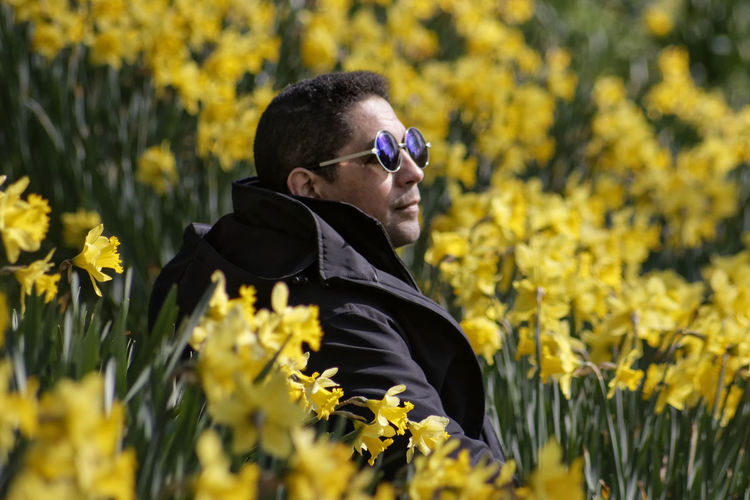 Close-Up Of Man In Yellow Flowers