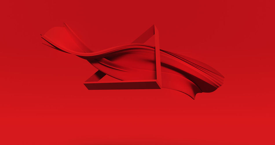 Low angle view of paper flag against red background