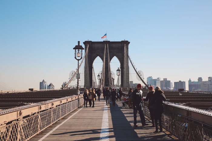 Adult Adults Only Architecture Bridge - Man Made Structure Built Structure City City Life Cold Connection Day December Full Length Large Group Of People New York New York City Outdoors People Sky Sunny Teamwork Travel Destinations Winter Young Adult Young Women
