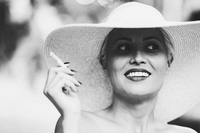 Hat Blackandwhite Black And White Black & White Smoke Shadows & Lights Beautyisourduty Portrait One Person Headshot Looking At Camera Human Body Part Front View The Portraitist - 2018 EyeEm Awards Young Women Smiling Women Human Face Beautiful Woman Leisure Activity Lifestyles Real People Close-up