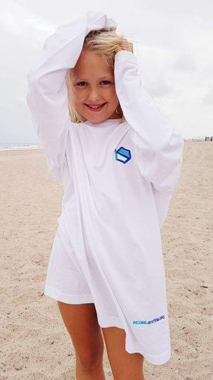 my small model Shirt White White Background White Color Blonde Blonde Girl Blonde Hair Model Modeling Modeling Shoot Posing Posing For The Camera Child Smiling Childhood Sea Portrait Beach Sand Dune Cheerful Girls Happiness 2018 In One Photograph
