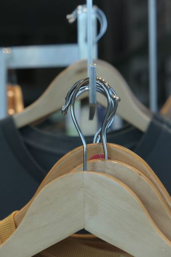 Retail  Retail Display Store EyeEm Selects Coathanger Hanging Focus On Foreground No People Indoors  Close-up Metal Still Life Rack Clothes Rack Clothing Fashion Wood - Material Hook