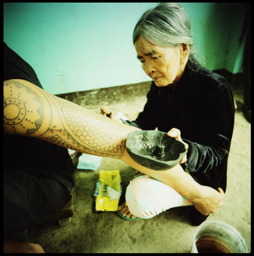 Apo Whang Od - the oldest tattoo artist in the world. The hundred year old still works everyday in her village Buscalan in the Kalinga mountains of Northern Luzon in the Philippines Adventure Age Analogue Photography Apo Whang Od Buscalan Philippines Film Photography Grace HERO Kalinga Mountains Northern Luzon Outdoors Pain Philippines Shadow Tattoo Tattoo Artist The Photojournalist - 2017 EyeEm Awards The Portraitist - 2017 EyeEm Awards Tradition Traditional Tattoo Traditional Tattoos Travel Wisdom Xpro