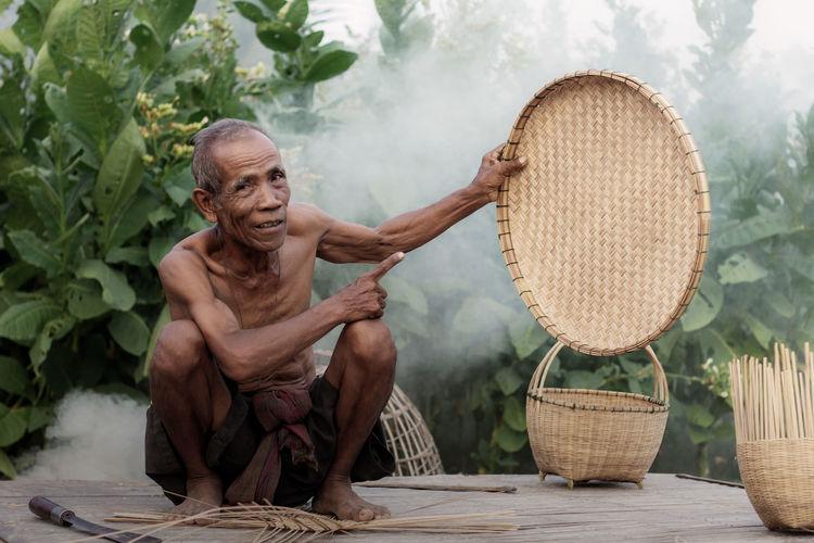 Woman sitting in basket