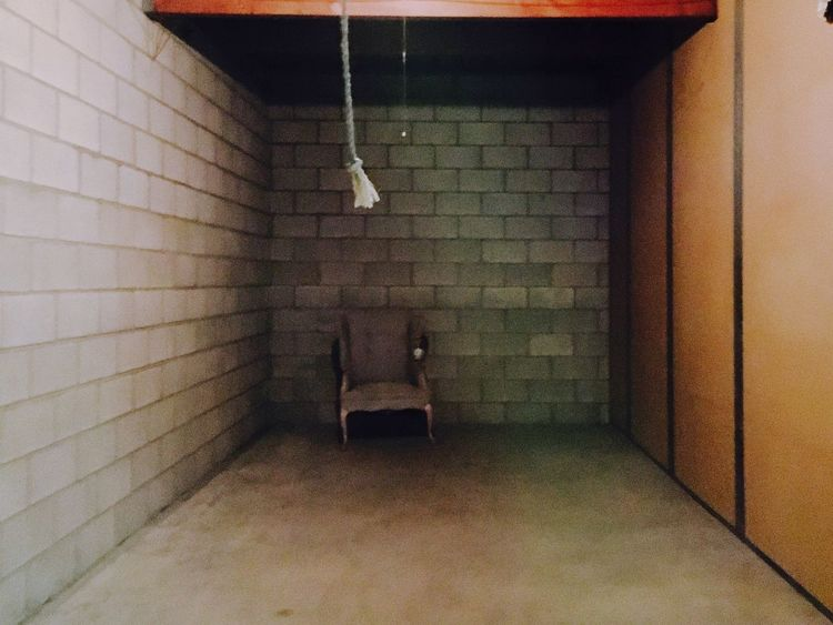 Lonely Chair Chair Storage Room Alone Single Last Last To Be Picked Indoors  Tiled Wall No People Illuminated Architecture Day Cinder Block Storage Facility Wingback Chair Concrete Floor