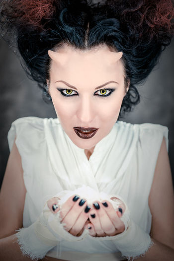 Portrait of devil woman holding heap of a white powder Art Attractive Brunette Girl  Caucasian Conceptual Demon Demonic Devil Drug Face Fantasy Female Hairstyle Hell Horned Horns Lens Makeup Mysterious Narcotic Satan Studio Shot Witch Woman Young