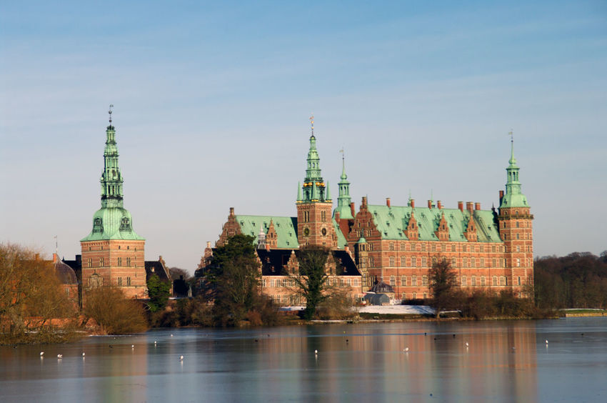 Castle Danish Architecture Denmark Frozen Monarchy Nordic Countries Renaissance Sunlight Winter Architecture Building Building Exterior Built Structure City Forest Frederiksborg Castle Hillerød History Hunting Area Nature No People Outdoors Park Plant Reflection River Sky Snow Spire  Tourism Tower Travel Travel Destinations Tree Water Waterfront