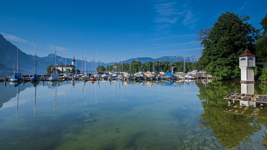 Hafen Traunsee Schloss Ort Schloss Ort Am Traunsee Salzkammergut, Austria Water Reflection Nautical Vessel Tree Sky Waterfront Transportation Mountain Mode Of Transportation Plant Moored Nature Day Beauty In Nature Scenics - Nature Architecture Built Structure No People Harbor Sailboat Outdoors Marina Yacht