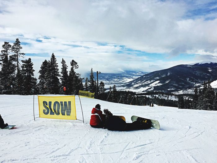 Snowboarders taking it nice and slow on the slopes. Skiing Snowboarding Colorado Denver Snow Mountains Keystone