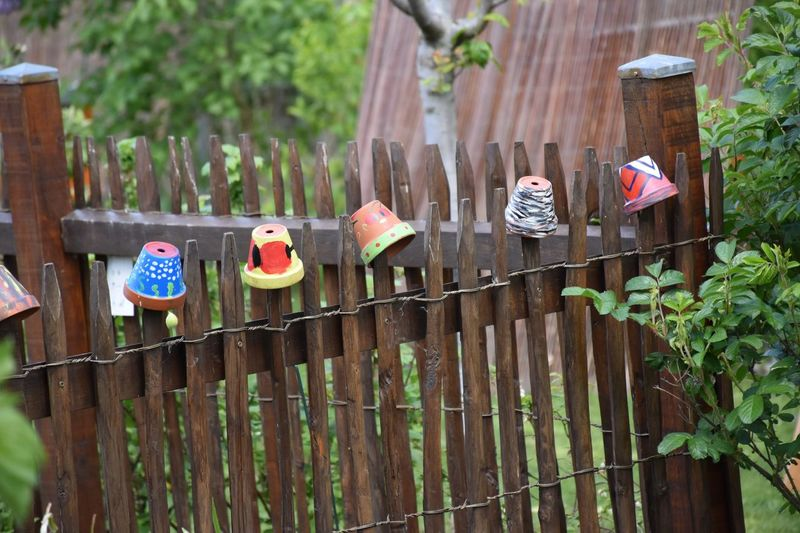 Clothes hanging on wooden fence in yard