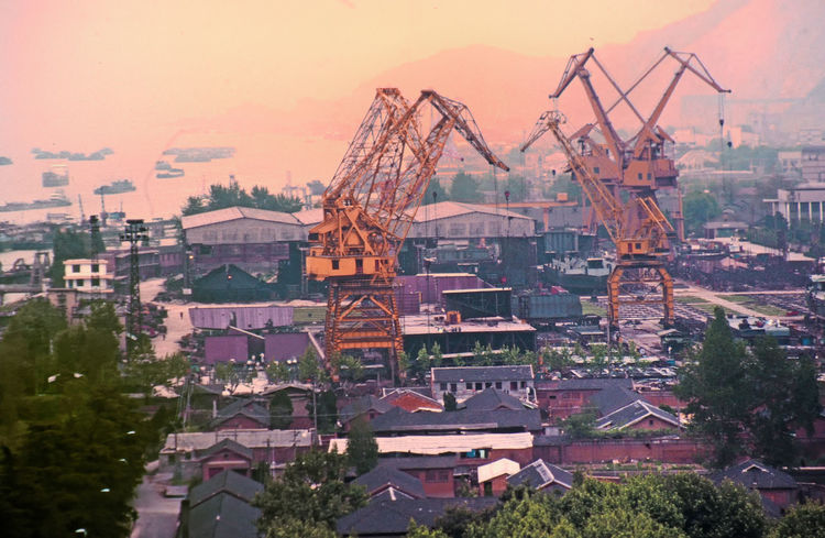 A shipbuilding yard in Nanjing, China Architecture Sunset Nature City Sky Day Outdoors Cityscape No People A Taste Of China Nanjing.China Shipbuilding Yard Building Exterior Built Structure Heavy Lifting Machinery
