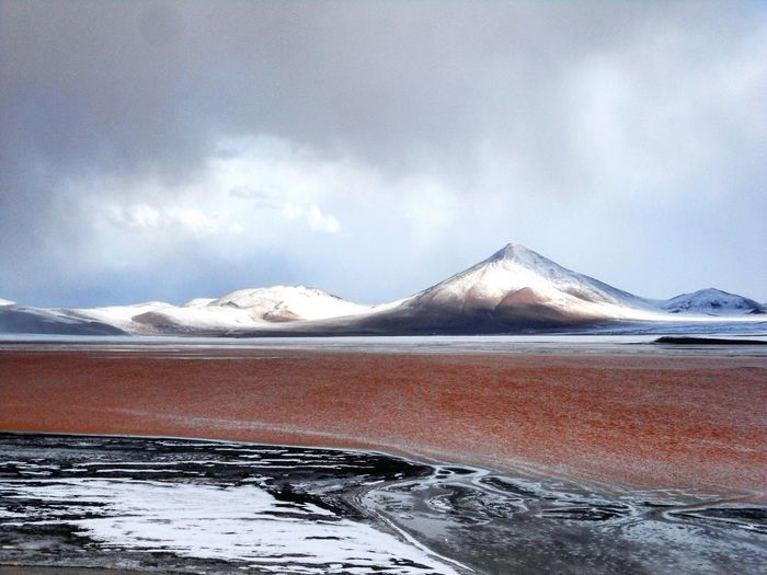 View of Laguna Colorada in South Bolivia during winter. Andes Red Lake Bolivia Beauty In Nature View Winter Landscapes Remote Location Remote Place Water Snow Mountain Cold Temperature Frozen Water Polar Climate Lake Flamingo Natural Phenomenon Power In Nature Natural Landmark Geology Iceberg - Ice Formation Glacier Rock Formation Geyser Volcanic Landscape Snowcapped Mountain Rocky Mountains Physical Geography Dramatic Landscape Mountain Range