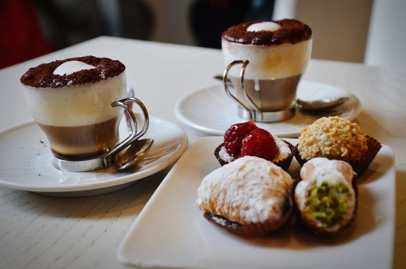 Coffee and cakes on table