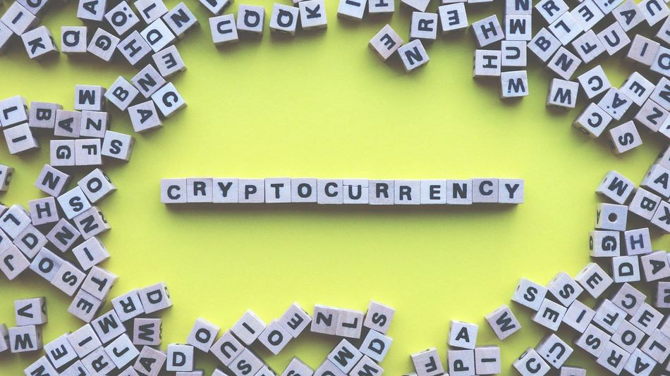 Letters Cryptocurrency in a yellow background Wood Dice Letters Cryptocurrency Yellow Background Blogger Blog Network Digital Currency Marketing Communication Multi Colored Studio Shot Text Close-up Western Script Dice Forming Capital Letter Written Information Sign Information