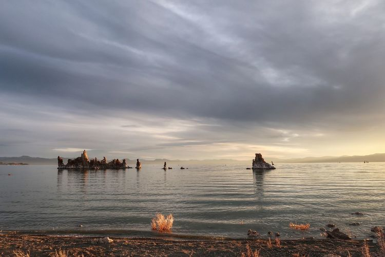 Landscape of tufa formations in the distance of Mono Lake at dawn Landscape Tufa Mono Lake Water Sky Cloud - Sky Sea Scenics - Nature Beauty In Nature Tranquil Scene Tranquility Sunset Nature Horizon Over Water Horizon Land Idyllic Beach Outdoors