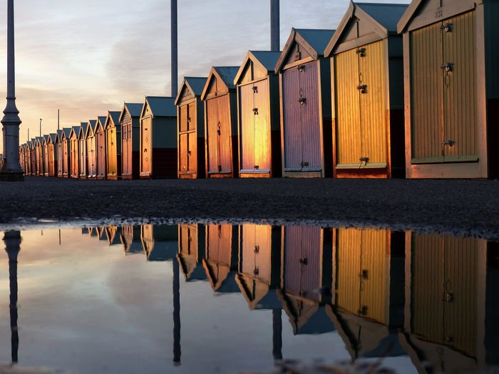 Wooden posts in row at sunset
