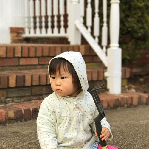 Portrait of a girl holding gardening rake