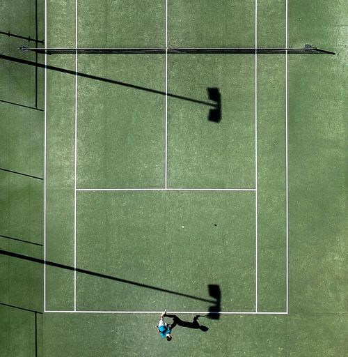 Directly Above Shot Of Athlete Playing At Tennis Court