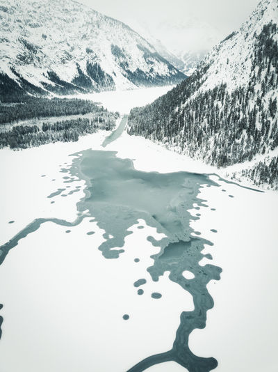 Beautiful Plansee captured during in winter by drone. Cold Temperature Winter Water Snow Scenics - Nature Tranquil Scene Tranquility Nature Beauty In Nature Lake Mountain Day No People Non-urban Scene Sky Environment Frozen Landscape Snowcapped Mountain Ice Melting Plansee Tirol  My Best Photo
