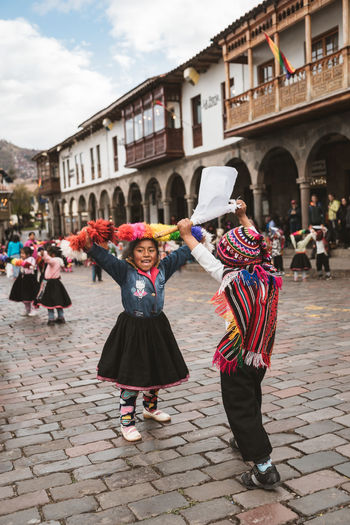 Peruvian children dancing to Peruvian folklore. Children Cusco Dance Dancing Happiness Happy People Kids Being Kids Peru Travel Photography Children Dancing Children Only Children Playing Costume Dancer Dancers Folk Folk Dance Folklore Hands Up Huayno Performance Peruvian Real People Smiling South America This Is Strength This Is Natural Beauty