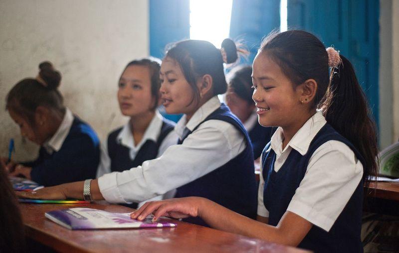 Students attending English class at school in Ghandruk, Nepal Nepal School Students Education NGO SocialWork Class Childhood Nepali  Girl Everyday Lifestyle Humanrights Women Around The World Women Girls Culture School Uniform Nonprofit Documentary