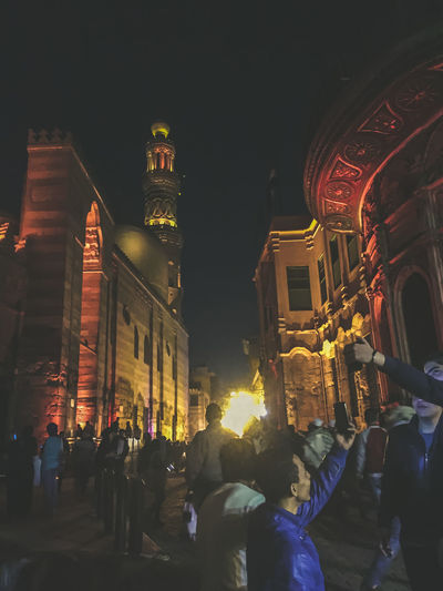 Adult Adults Only Al Muizz Street City Clock Crowd Illuminated Islamic Architecture Islamic Art Islamic Cairo Islamic Calligraphy Islamic Walk Large Group Of People Men Mosque Night Nightphotography Outdoors People Streetphotography Travel Destinations