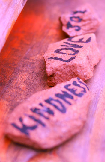 Kindness Love Bekind Close-up Earthday Joy No People Pink Color Rocks Selective Focus Text Wood - Material