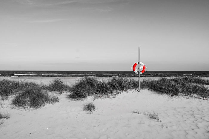 Baywatch Beach Beachphotography Beauty In Nature Blackandwhite Coloursplash Day Flag Horizon Over Water Life Life Saving Lifebelt Nature No People Outdoors Red Rescue Safety Sand Save Life Sea Security Sky Tranquility Water