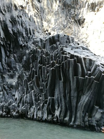 Rock formations by lake