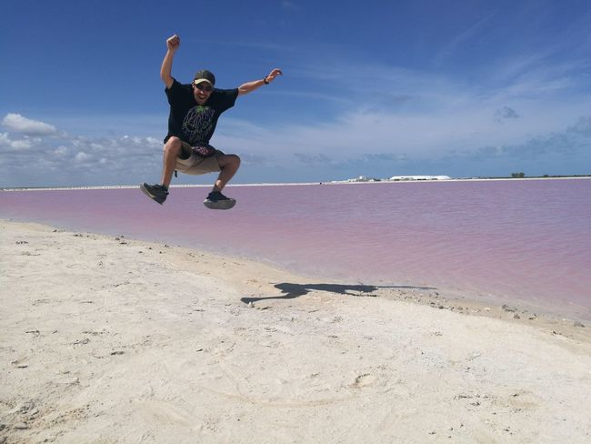 Sand One Man Only Beach Only Men Sea Adult Full Length One Person Jumping People Men Mid-air Summer Vacations Sky Outdoors One Young Man Only Young Adult Day Las Coloradas, Yucatán, México. Salinas Salty Water Pink Water Landscape Horizon Over Water Inner Power