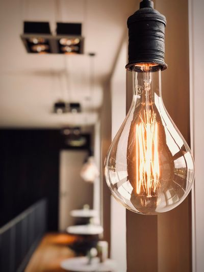Close-Up Of Illuminated Light Bulb At Home