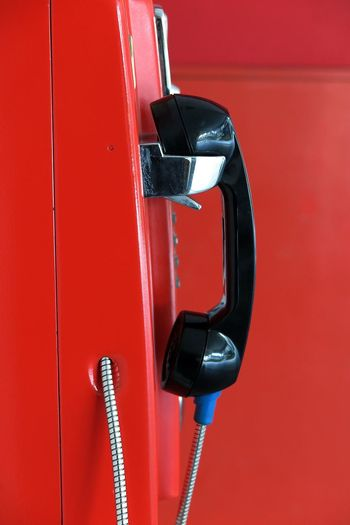 Close-up side view of a pay phone