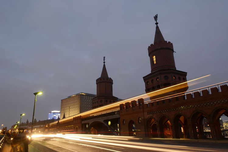 Illuminated Light Trail At Oberbaum Bridge Against Sky