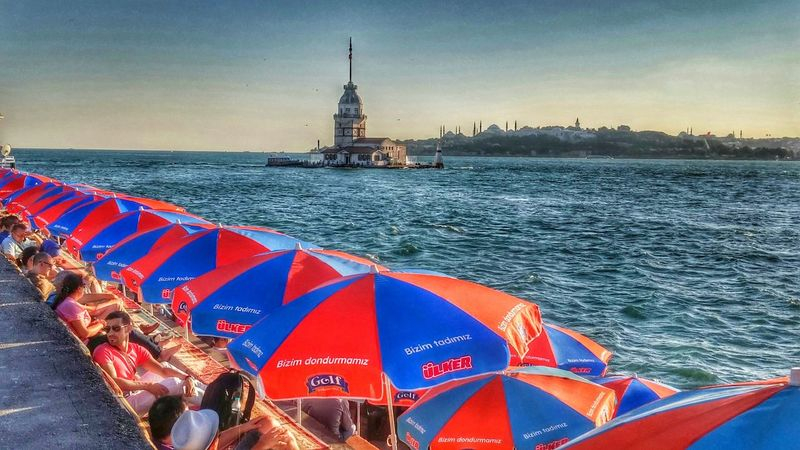 Istanbul - Bosphorus Istanbul Turkey istanbul turkiyeIstanbul City Kızkulesi Kizkulesi Kizkulesi Maidens Tower  Deniz Travel Destinations Sea Outdoors Architecture Flag Travel Celebration Multi Colored History City Day Vacations Cultures Clock Tower Crowd People Sculpture