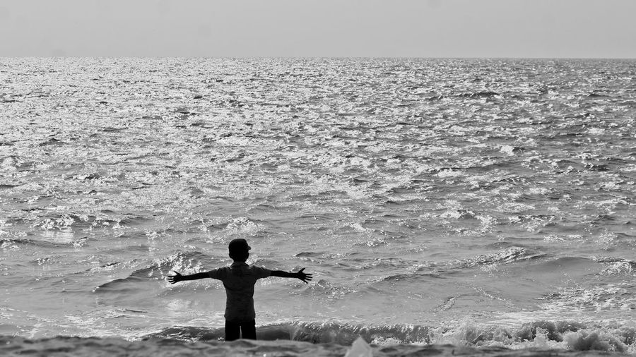 Open arms for an open sea.... Sea Child Solitude Solitary Openarms Silhouette Waves Calmsea Blackandwhite Monochrome The Following