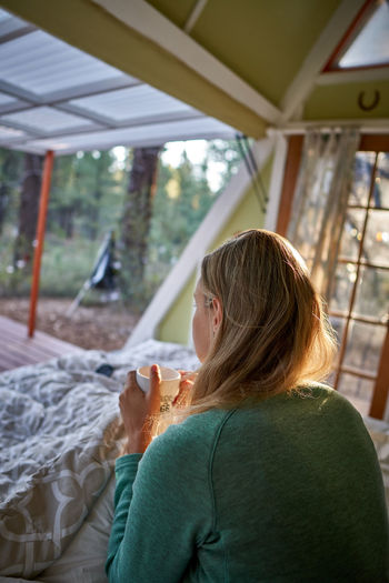 Morning coffee at Zion Real People Rear View One Person Adult Women Hair Leisure Activity Lifestyles Focus On Foreground Casual Clothing Day Indoors  Headshot Looking Hairstyle Waist Up Brown Hair Sitting Portrait Morning Coffee Wake Up And Smell The Coffee Zion National Park