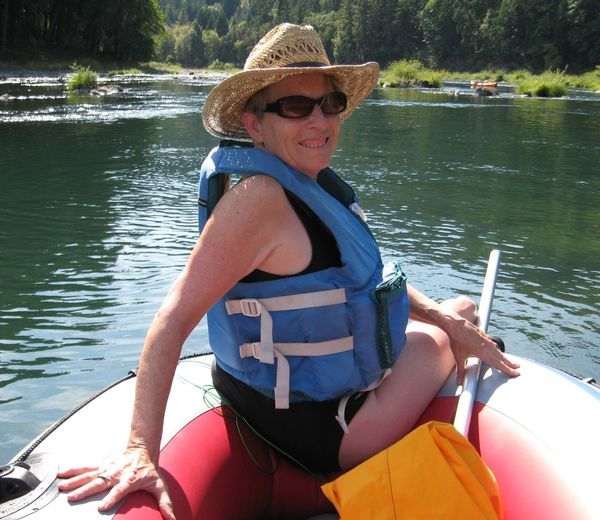 Portrait Of Smiling Mature Woman Canoeing