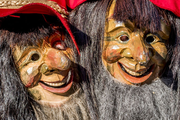 Close-up of two traditional Fasching ,carnical, masks in Stut tgart, Germany Carnival Fasching Monday Stuttgart Tuesday Ugly Bad Beard Clown Costume Fasnet Fooling Around Grimace Halloween Historic Lenten Mask Mug Rosé Sillouette Swabian Throve Traditional Witch Wuerttemberg