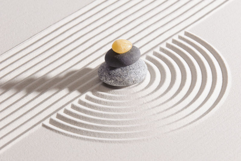 Stack stones on patterned sand