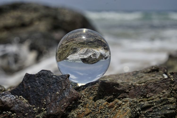 Rock Sphere Rock - Object Solid Transparent Nature Focus On Foreground Water Sea Crystal Ball Glass - Material No People Day Outdoors Reflection Beauty In Nature Close-up Land Sky Crystal